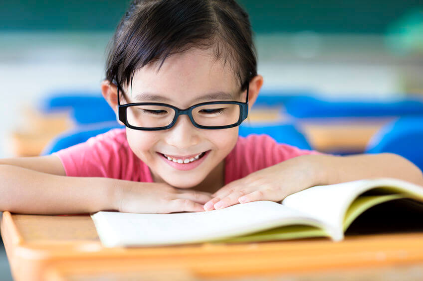 43491722 - happy little girl studying in the classroom