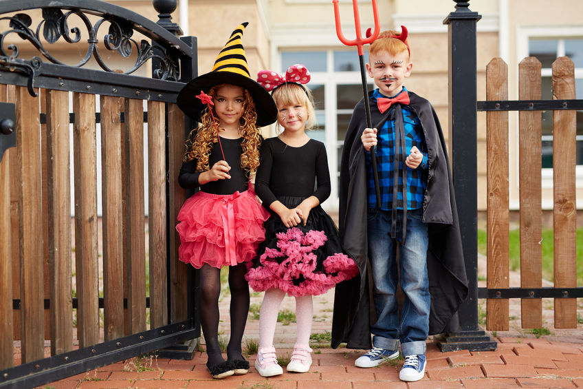 62863859 - group of cute children in halloween costumes